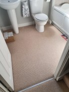 Bathroom ready for transformation from carpet to tiles