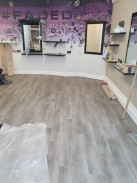 Faded hair salon fitted with LG luxury vinyl tiles