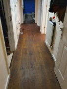 Finishing look of real wood engineered from hallway to lounge