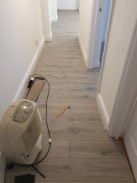 Hallway in flat fitted throughout with lifestyle chelsea laminate